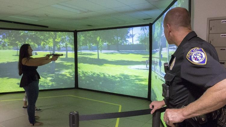 Laser simulation gives Orange Glen students a chance to experience police work